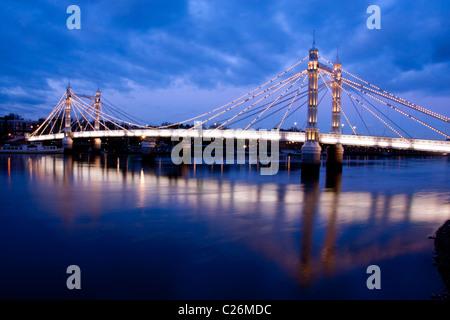 Albert Bridge and River Thames at night Chelsea London England UK - Stock Photo