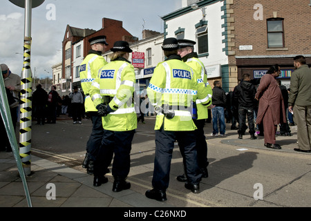 Police grouped at the counter protest against the English Defence League (EDL) protest in Blackburn, Lancs.