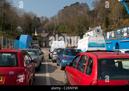 Cars waiting to disembark from the King Harry ferry on the river Fal near Truro in Cornwall, UK - Stock Photo