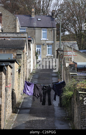 A washing line strung across a back street in Stanhope, Co. Durham, North East England, UK - Stock Photo