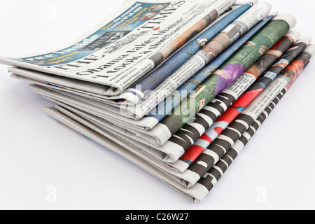 UK, Europe. Pile of newspapers - Stock Photo