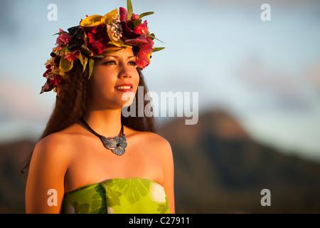 Alii Kai Hula dancer poses on Waikiki Beach with Diamond Head as backdrop - Stock Photo