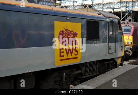 English Welsh & Scottish Railway logo on DB Schenker Rail freight train in Waverly Station Edinburgh Scotland - Stock Photo