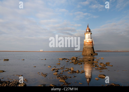 Plover 2 lighthouse in Morecambe bay with Heysham nuclear power station in the distance - Stock Photo