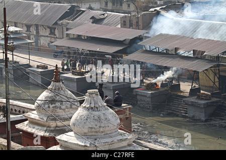 Funeral rite burning bodies at Pashupatinath temple. Kathmandu, Nepal - Stock Photo