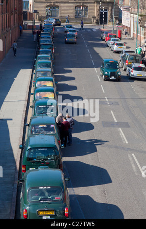 taxis waiting in a line outside the railway station Nottingham city centre England UK GB EU Europe - Stock Photo
