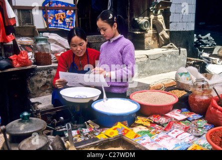 Mother and daughter in market, Kaili, Guizhou, China - Stock Photo