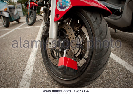 Motorcycle and wheel lock in Monte Carlo. - Stock Photo
