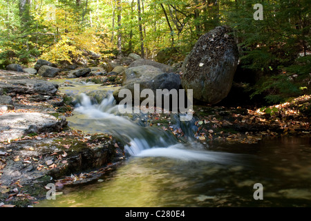 Water spills over rocks in Maine's western mountains, White Mountains National Forest. - Stock Photo