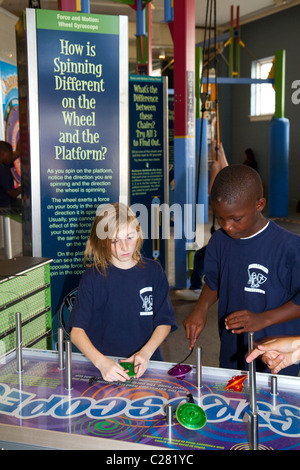 Children using an interactive exhibit at the Gulf Coast Exploreum Science Center in Mobile, Alabama, USA. - Stock Photo
