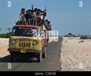 Locals are taking a ride in a truck near Rameswaram, in Tamil Nadu state, India - Stock Photo