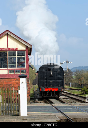 Steam locomotive passes in front of the signal box at Ramsbottom Station on the East Lancs Railway - Stock Photo