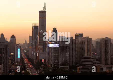 Skyline of Shenzhen in dusk. - Stock Photo