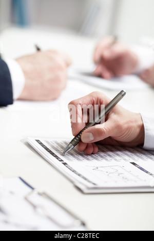 Image of businesswoman's hand writing - Stock Photo