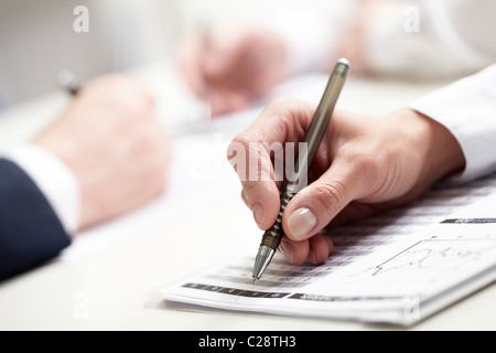 close-up of businesswoman's hand writing - Stock Photo