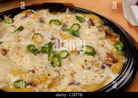 Korean food sale on restaurant , South Korea Chili Chicken with smashed sweet potato on the mozzarella cheese - Stock Photo