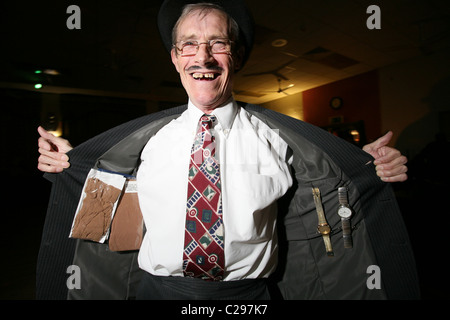 Spiv wearing jacket with stockings and watches attached for sale, London, England, UK. Photo:Jeff Gilbert - Stock Photo