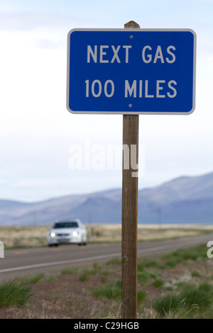 Next gas 100 miles road sign at the Oregon/Nevada border in McDermitt, USA. - Stock Photo