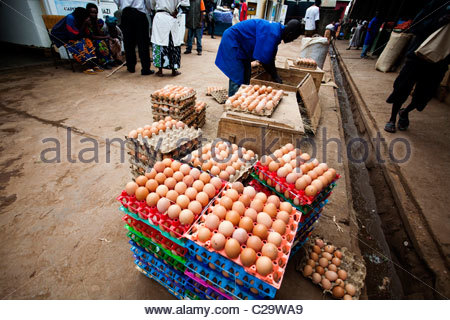 Stacks of eggs wait to be sold in a local market in Kigali, Rwanda. - Stock Photo
