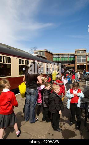 Crowds and school children  at Bolton Street Station, Bury, on the East Lancs Railway, Lancashsire, UK - Stock Photo