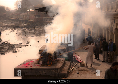 Hindu funeral rite. Burning bodies on pyre at Pashupatinath Temple. Nepal, Asia - Stock Photo