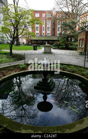 View through Postman's Park to the Watts Memorial, City of London, UK - Stock Photo
