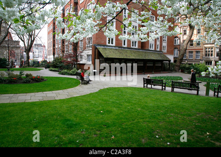 View across Postman's Park to the Watts Memorial, City of London, UK - Stock Photo