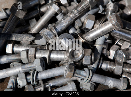 Pile of nuts and bolts, England - Stock Photo