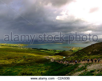 Pilgrimage up Croagh Patrick mountain in Ireland. - Stock Photo