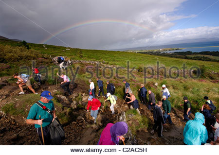 Pilgrims on Croagh Patrick mountain in Ireland. - Stock Photo