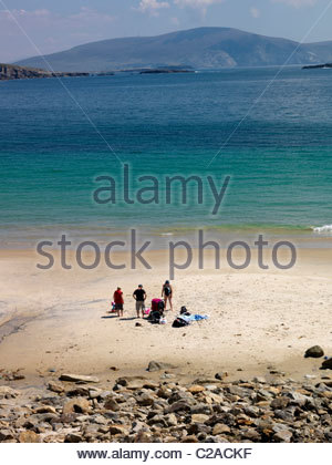 Bathers on a remote beach in the west coast of Ireland. - Stock Photo