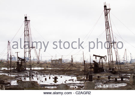Pools of oil in polluted oil fields in Balakhani, Azerbaijan. - Stock Photo