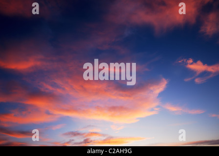 Dark red sunset clouds and deep blue sky - Stock Photo