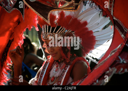 A girl dancing in a parade at Notting Hill Carnival, London, England - Stock Photo