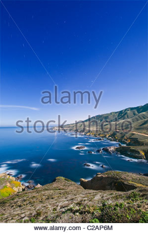 Highway 1 along the Big Sur coastline under the full moon. - Stock Photo