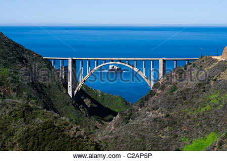 Bixby Bridge and the Pacific Ocean under the full moon. - Stock Photo