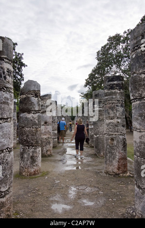 Alley of stone columns in Chichen Itza, mayan archeological site, Mexico - Stock Photo