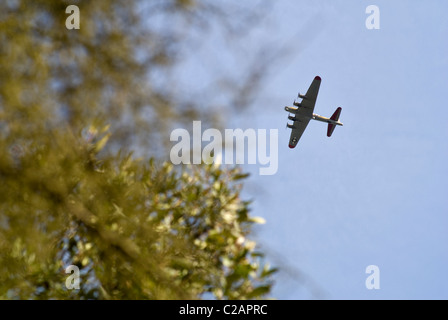 A World War two era Boeing B-17 bomber flies over Los Angeles, California on a sunny day in 2007. © Craig M. Eisenberg - Stock Photo