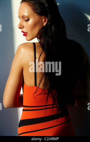 Elegant woman looking aside - Stock Photo