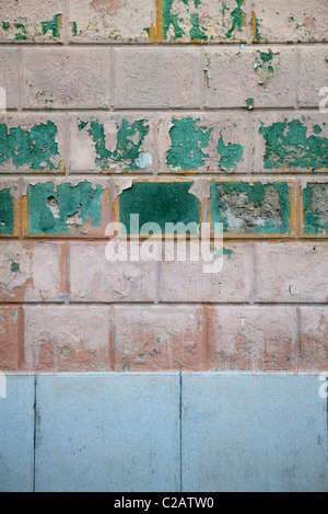 Old brick wall with peeling paint, close-up - Stock Photo