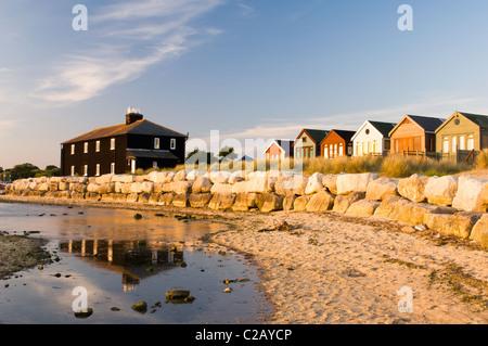 Beach huts on Mudeford Bank - Stock Photo