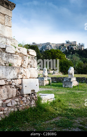 Greece, Athens, the Acropolis of Athens, Erechtheum and Propylaea on the hill in the background - Stock Photo