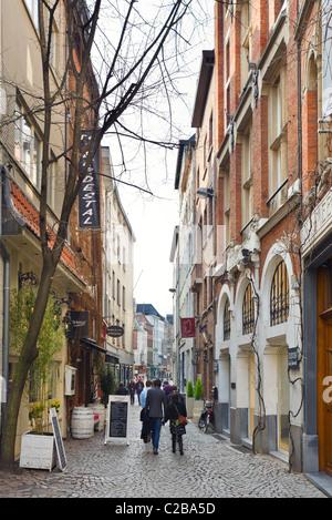 Narrow cobbled street (Wijngaardstraat) in the old city, Antwerp, Belgium - Stock Photo