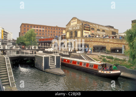 A narrowboat at Hampstead Road Lock on the Regents Canal at Camden Town London England UK - Stock Photo