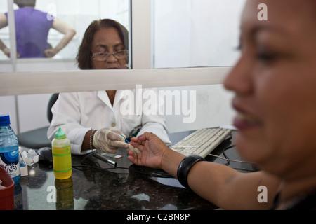 Collecting blood by using finger-stick for malaria laboratory diagnostic test. Fundação de Medicina Tropical do - Stock Photo