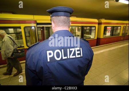 A police officer at the S-Bahn station Potsdamer Platz, Berlin, Germany - Stock Photo