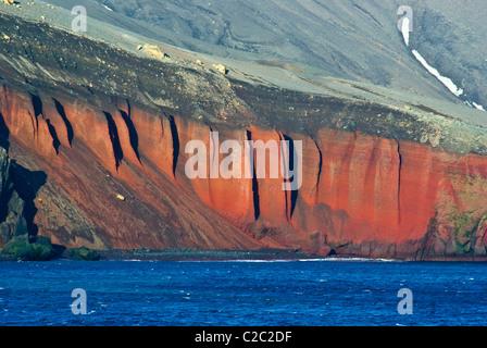 A rugged cliff face and escarpment surrounding a volcanic caldera. - Stock Photo