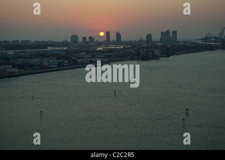 Sunrise in Miami Beach, seen from Downtown Miami. - Stock Photo
