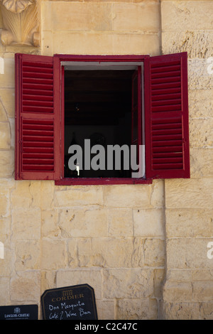The open shuttered window of café bar in Mdina Malta - Stock Photo