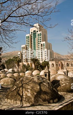 Four Seasons Hotel and Takiyya as Suleimaniyya a turkish style mosque Damascus Town City Syria Syrian - Stock Photo